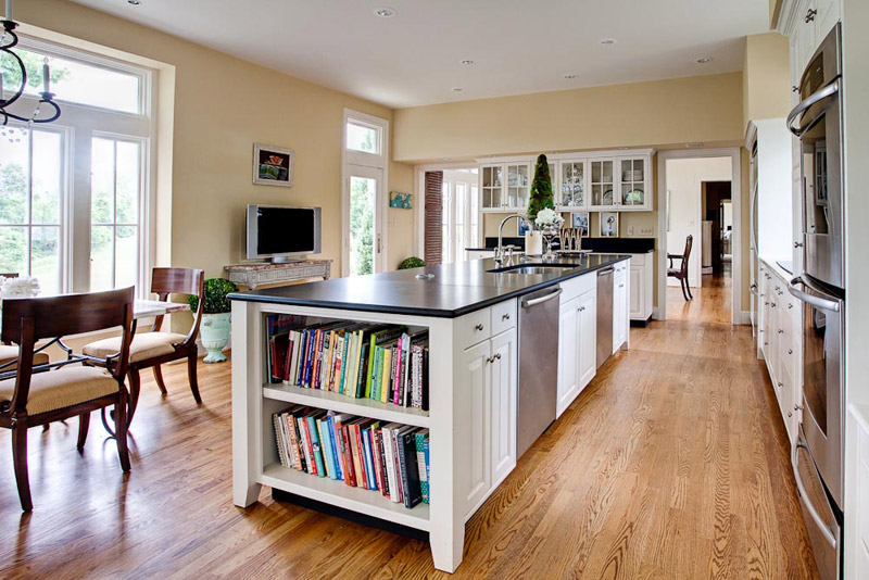 Long island with seating on far side and space for cookbooks.