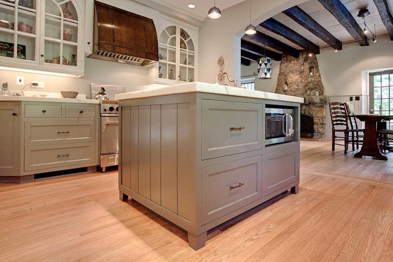This island in a remodeled kitchen leaves plenty of room to work around it.