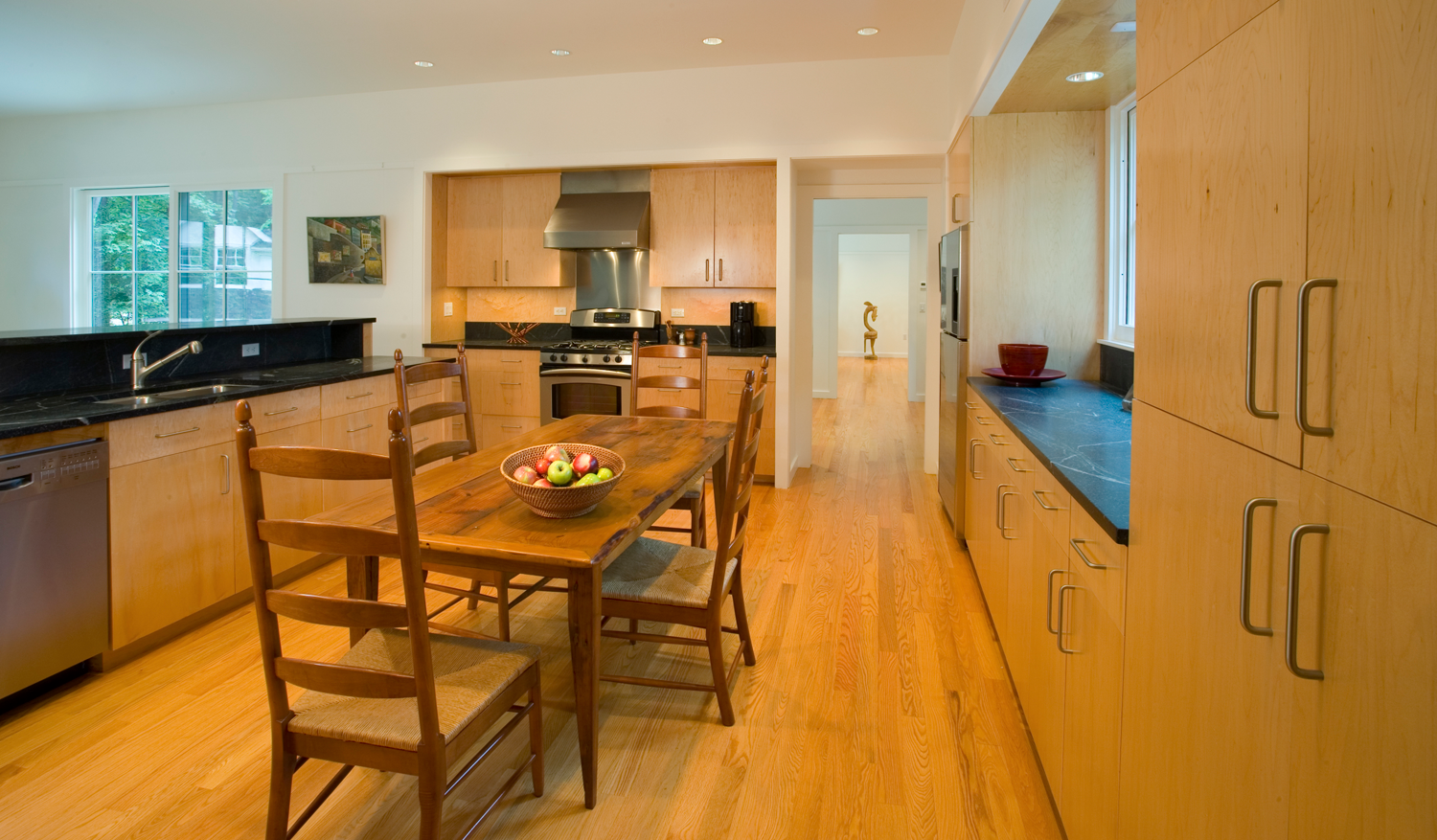 The island, which contains the sink and dishwasher, separates the kitchen from the living room, leaving ample room for the table.