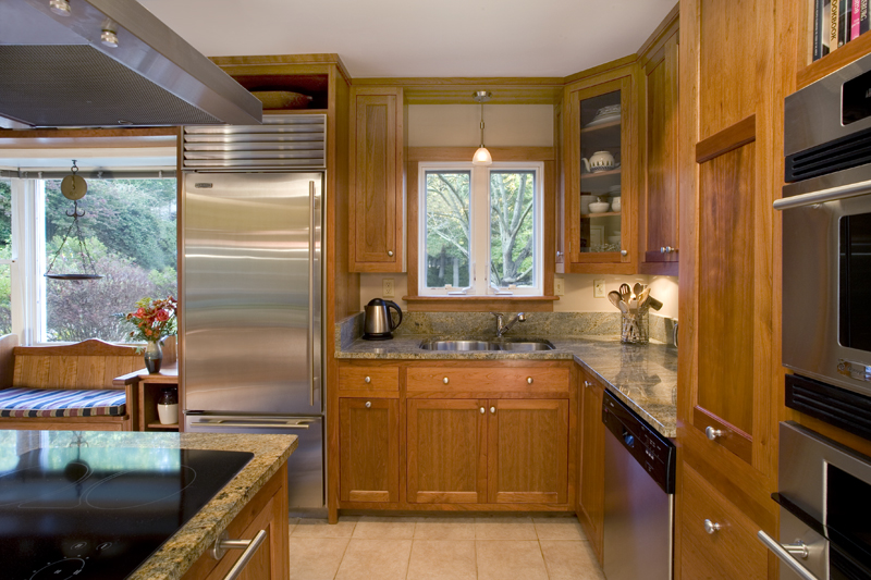 A narrow galley kitchen became more open and efficient.