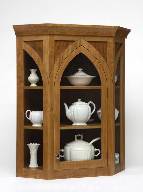 This corner display cabinet combines cherry, walnut, and Brazilian cherry.