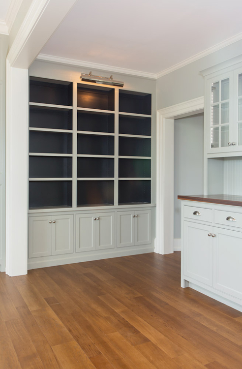 A built-in library and storage space adjacent to the kitchen.