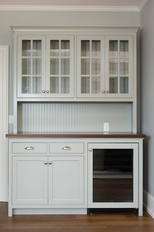 Display hutch with built-in wine cooler and beaded backing.
