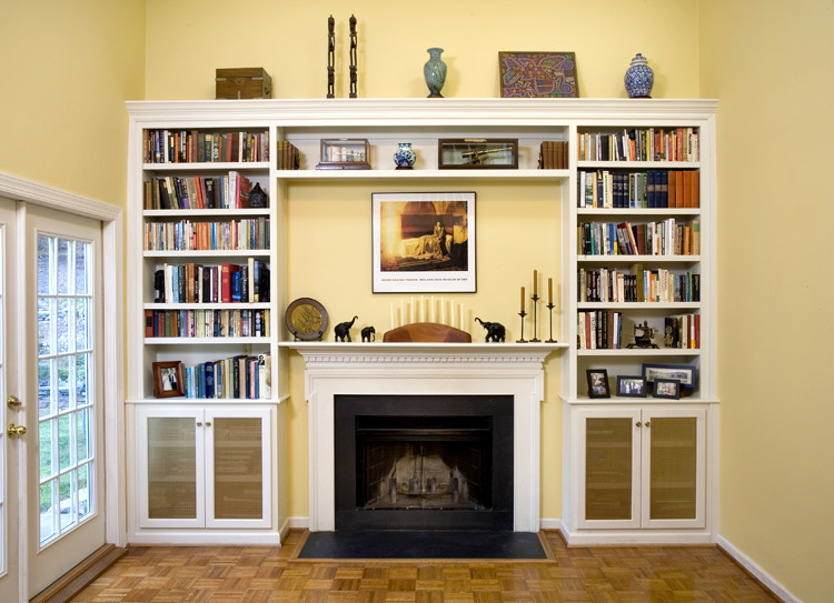 The blank wall surrounding a fireplace became much more useful and interesting with the addition of these built-ins.