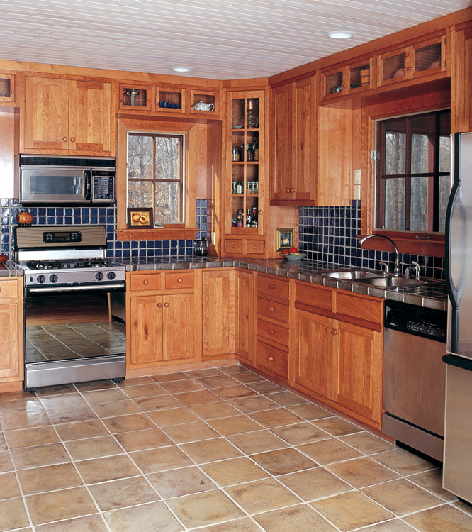 This smaller kitchen in inset cherry still has room for attractive display/storage space up high.
