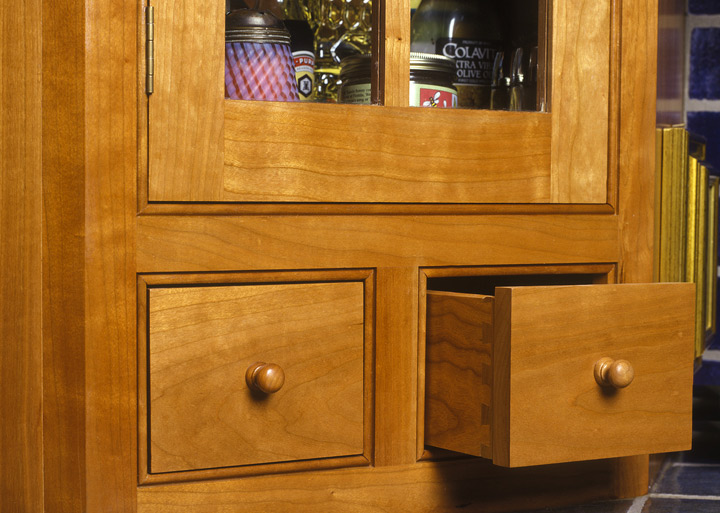 All the door and drawer openings have a bead as shown in the detail.