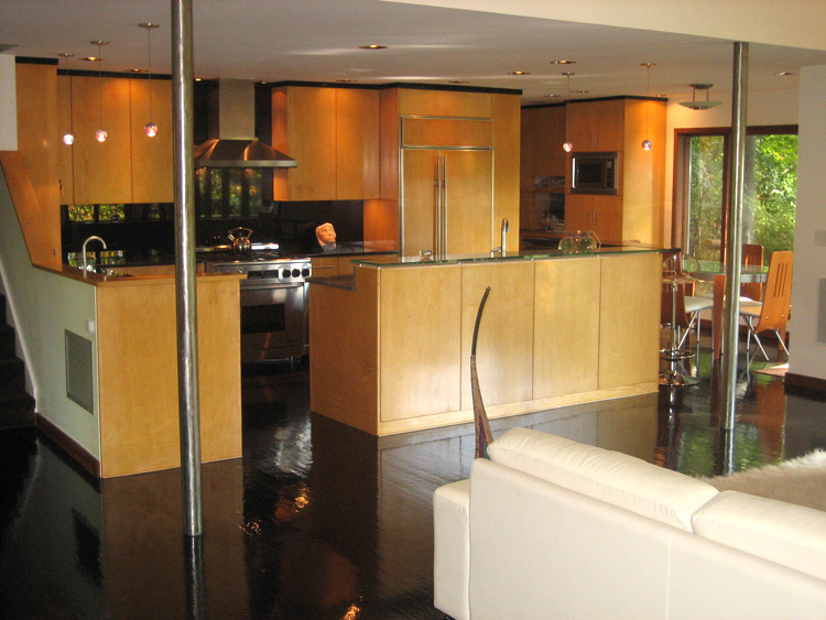 A spacious contemporary kitchen with full overlay natural maple fronts.