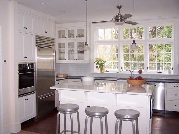 The dark floor and dark counters are offset by white cabinest that get a lot of natural light.