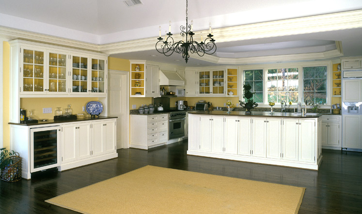 We moved the dining table to take this picture of a spacious kitchen where the cabinets extend into the dining area.