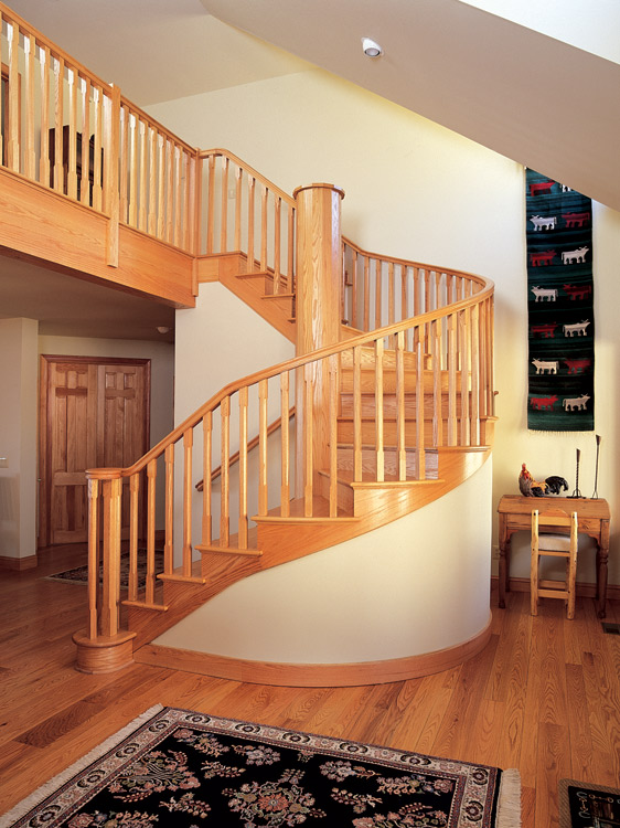 This red oak spiral stair has a fifteen sided post at its center. The balusters, like everything else, are custom built.