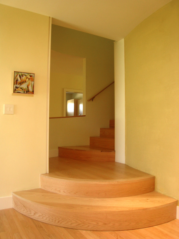 Curving steps in a contemporary style give a pleasing start to the stairs.